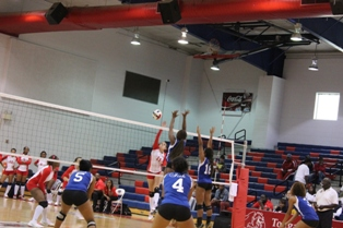 Marcella Oliveira goes up for a kill over Fisk defenders.