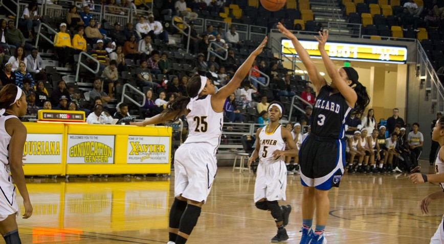 Shaelynn Moore scores two of her team-high 15 points with a jumper over Whitney Gathright.