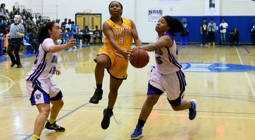 Dillard senior Keona Favis steals the ball from Xavier's Maya Trench at the Bleu Devil Classic.