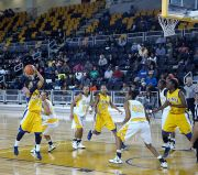 April Perry scored 26 points to lead SUNO's upset of 9th-ranked Xavier